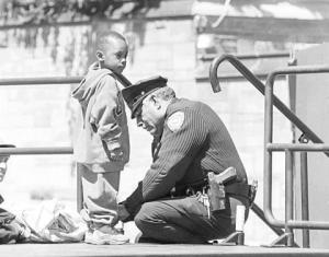 Cop tying shoe Cambridge County PD