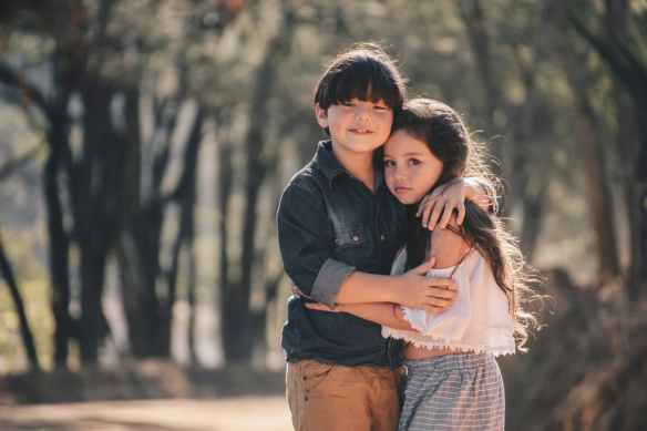 girl and boy standing and hugging
